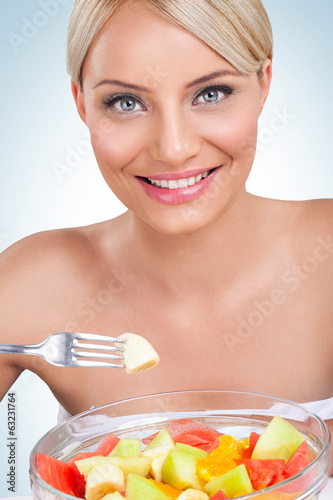 Woman with fruit salad