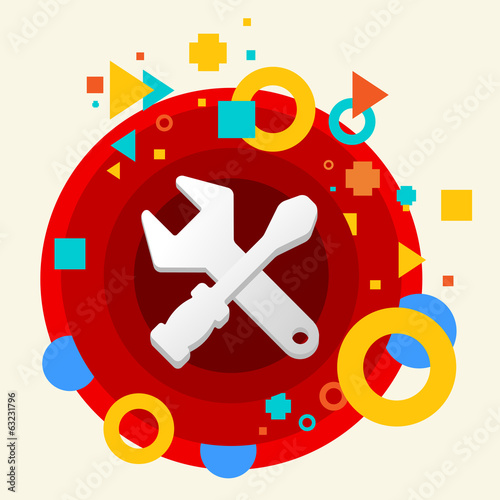 Tools screwdriver and wrench on abstract colorful made from circ