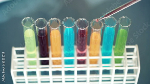 Close up shoot of scientist doing lab test with chemicals
