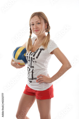 Happy female volleyball player holding ball on white background