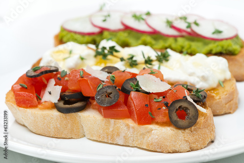 ciabatta with tomatoes, olives, parmesan cheese