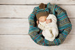 baby newborn sleeping in woolen hat on white wooden background