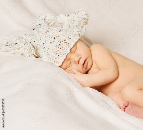 baby newborn portrait, kid sleeping in hat on white background