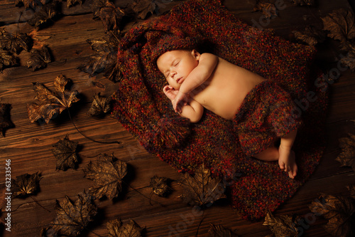 baby newborn artistic portrait, kid sleeping in woolen hat