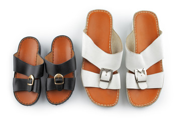 Traditional Arabic sandals shot against a white background
