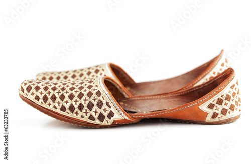 Traditional Arabic slippers shot against a white background