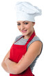 Confident young female cook