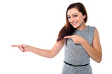 Stylish teen girl pointing away