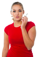 Young woman posing with cigarette