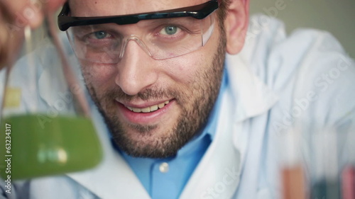 Portrait of young happy scientist in laboratory