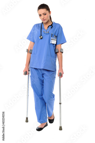 Lady doctor walking with help of crutches