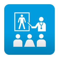 Etiqueta tipo app azul simbolo facultad de medicina