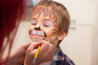 Leinwanddruck Bild - Portrait of a boy with painted face