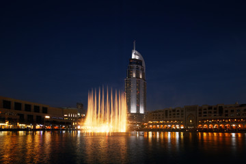 The Dubai Fountain performs and dances to the beat of the music