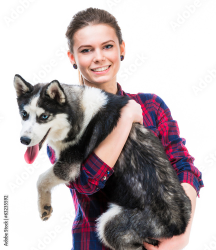 women with her puppy Husky