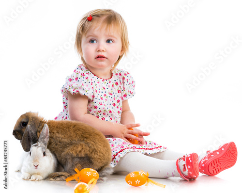 little girl  with two rabbits