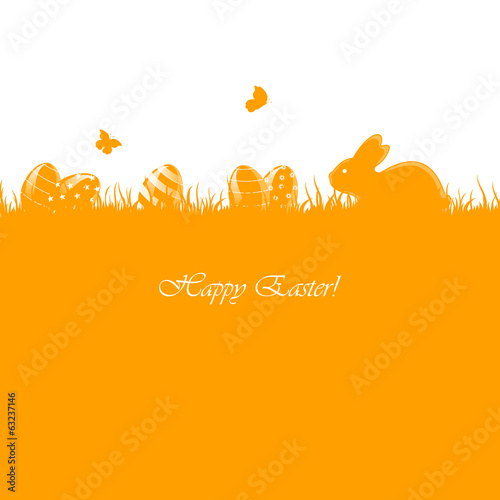 Easter eggs and rabbit on orange grass