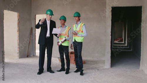 1of23 Manual worker, engineer and architect in construction site