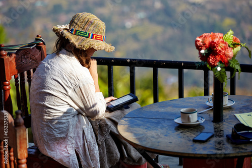 reading woman sit on the terrace of the cafe