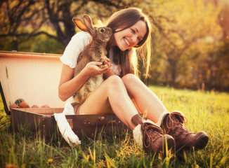 Vintage style photo from a beautiful young woman with her bunny