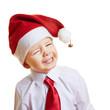Grinsendes Kind mit Weihnachtsmütze