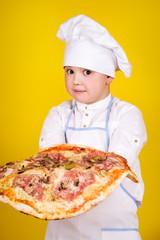 Boy making pizza