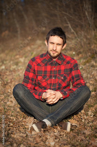 Portrait of a young handsome man outdoors