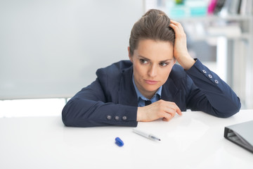 Stressed business woman near flipchart