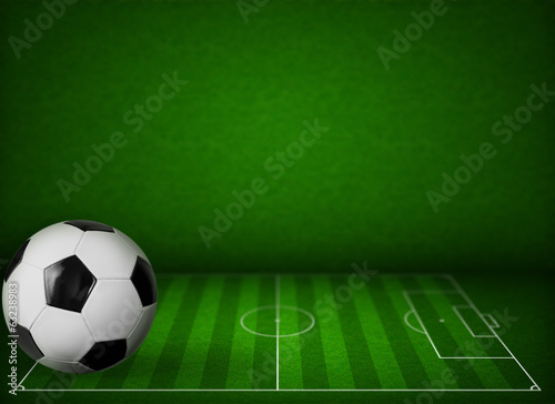 Grass soccer or football field background with ball