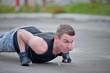 Man doing pushups on the street