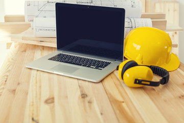 Contemporary laptop on placework for construction worker