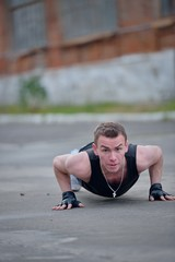 Man doing pushups on the street
