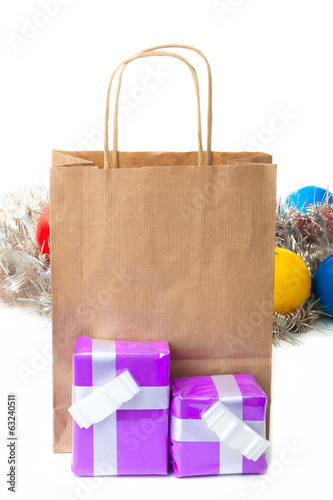 Gift boxes with a brown paper shopping bag