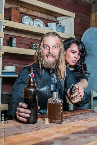 Crazed Western Man With Woman at Table
