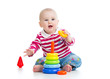 adorable baby playing with color toy