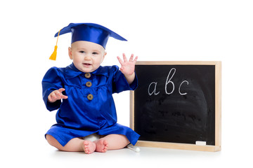 Baby in academician clothes  sitting at chalkboard