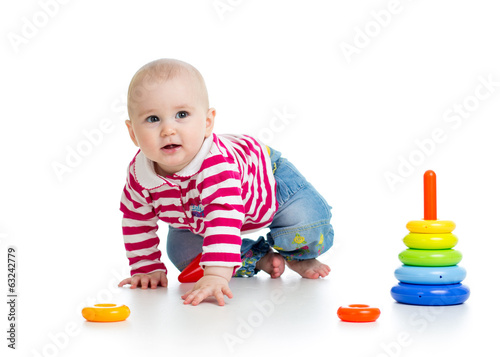 baby boy playing with educational toy