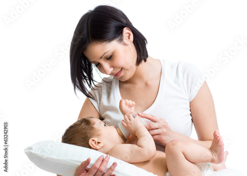 mom feeding baby from milk bottle