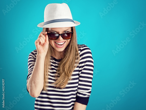 Pretty laughing woman tourist ready for summer adventure