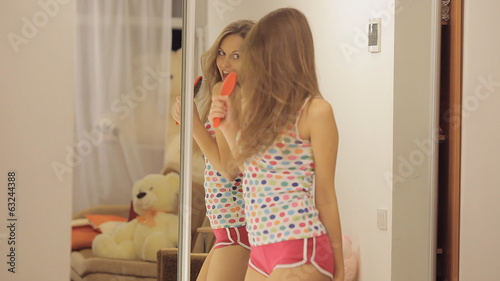 Girl dances and sings before the mirror Full HD 1080 NTSC