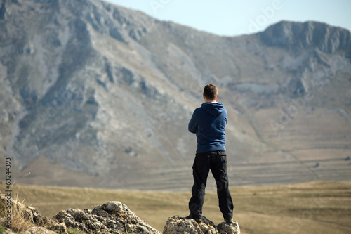 Man r standing on top of mountain