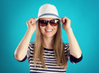 Young woman in sunglasses.  Vacation and holidays concept