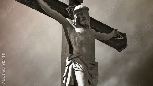 Crucifixion. Christian cross with Jesus Christ statue.