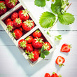 Fresh ripe red strawberries in boxes