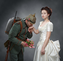 German soldier kissing a lady's hand