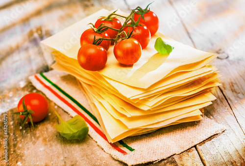 Preparing Italian lasagne with fresh ingredients