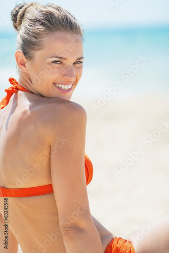 Portrait of happy young woman on beach