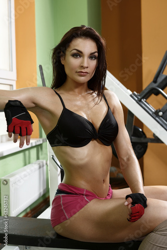Beautiful girl bodybuilder in the gym