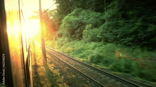 View of sunrise from outside train window.