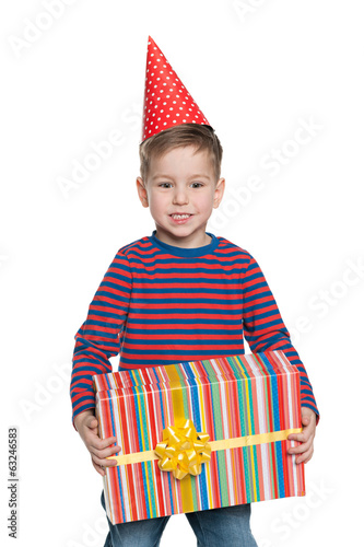 Little boy holds a gift box